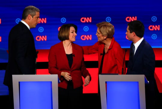 From left, Rep. Tim Ryan, D-Ohio, Sen. Amy Klobuchar, D-Minn., Sen. Elizabeth Warren, D-Mass., and South Bend Mayor Pete Buttigieg talk after the first of two Democratic presidential primary debates in Detroit.