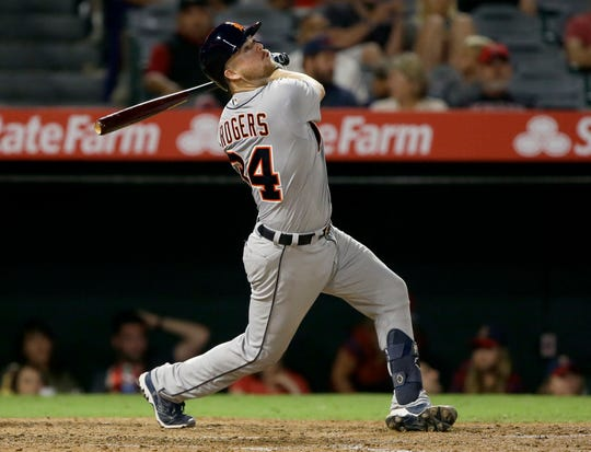 The Detroit Tigers' Jake Rogers follows through on a single against the Los Angeles Angels during the ninth inning.