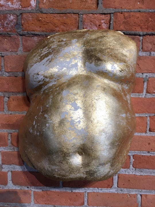 """""""Hungry Ghost Casting 1"""" by Oksana Mirzoyan, in which a male belly approximates the look of a pregnant woman."""