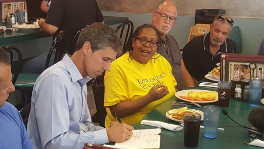 Democratic presidential hopeful Beto O'Rourke took notes Wednesday (July 31, 2019) as he talked to potential voters in a Mount Clemens restaurant. The former Texas congressman was courting Macomb County voters.