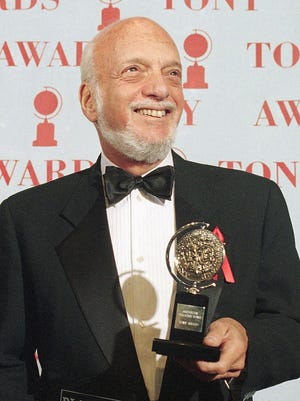 "Harold Prince holds his Tony award for best director in a musical for ""Show Boat,"" at Broadway's Minskoff Theater in New York on  June 4, 1995."