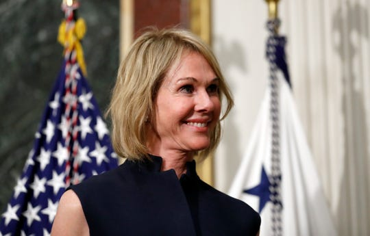 In this Sept. 26, 2017, file photo, U.S. Ambassador to Canada Kelly Knight Craft stands during her swearing in ceremony in the Indian Treaty Room in the Eisenhower Executive Office Building on the White House grounds in Washington.