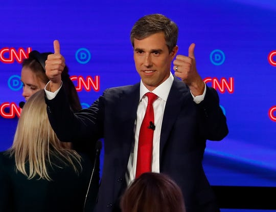 Former Texas Rep. Beto O'Rourke gives a thumbs up during a break in the first of two Democratic presidential primary debates Tuesday in Detroit.