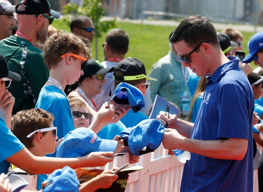 Monster Energy NASCAR Cup Series driver Alex Bowman (88) signs autographs before the 2018 Go Bowling at The Glen at Watkins Glen International.