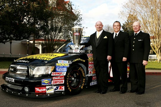 Todd Bodine, left; Brett Bodine, center, and Geoff Bodine pose for a picture before the  NASCAR Craftsman Truck Series banquet in Lake Buena Vista, Fla., in 2006. Todd won the Truck Series title that year.