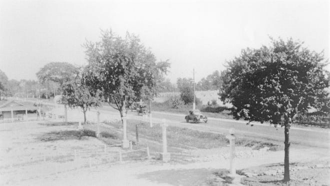 A lone car is visible traveling in front of the Rainbow Garden in 1926.