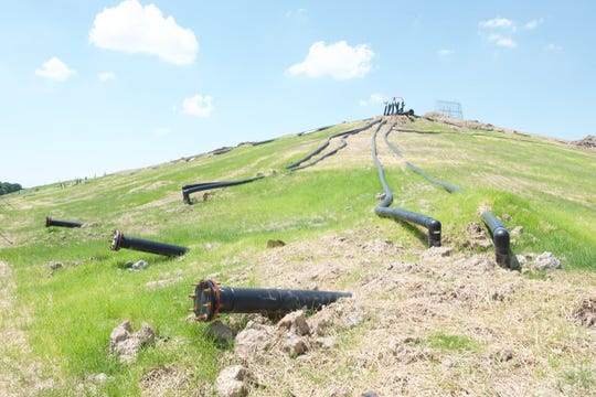 Landfill Gas Collection System Piping and Freshly Completed Grass Seeding.