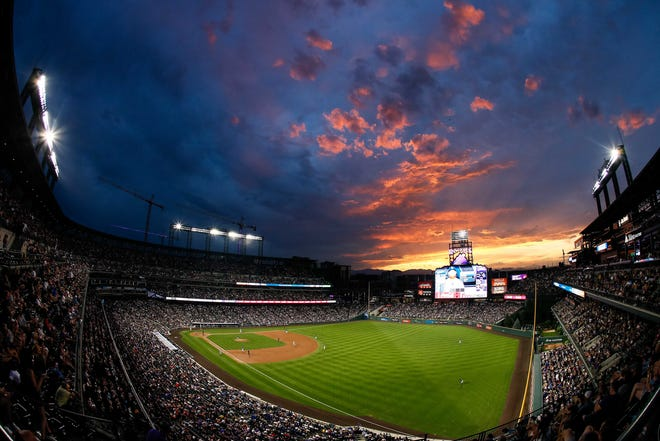 Fans at the Colorado Rockies game Tuesday, July 30, 2019, were treated to a colorful sunset over Coors Field in Denver. The Rockies are off Thursday and begin a three-game home series against the San Francisco Giants at 6:40 p.m. Friday.
