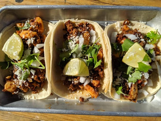 A trio of chorizo-octopus tacos from the new Enter the Dragon in Cape Coral.