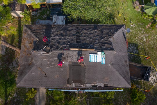 Roofing working on a home