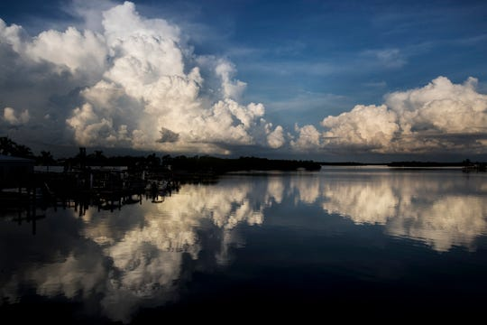 Cumulus clouds form over Estero Bay photographed from the Hurricane Pass Bridge on San Carlos Island on July, 25, 2019. Cumulus clouds are manifestations of convection. They form when bubbles of buoyant air rise. The towering clouds that produce showers of rain, snow and/or hail are called ÔcumulonimbusÕ