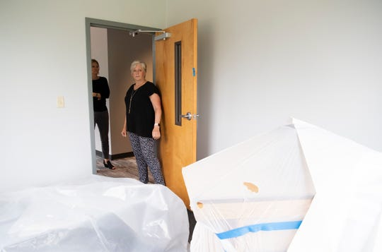 Greer Cultural Arts Supervisor Robin Byouk (right) and Director of The City of Greer Parks and Recreation Department Ann Cunningham show one of the art studios in the new Center for the Arts in Greer Wednesday, July 31, 2019.