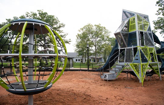 A playground is under construction at the new Center for the Arts in Greer Wednesday, July 31, 2019.