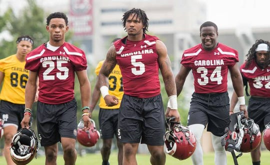 South Carolina running backs AJ Turner (25), Rico Dowdle (5) and Mon Denson (34).
