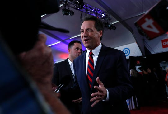 Montana Gov. Steve Bullock talks to reporters after the first of two Democratic presidential primary debates hosted by CNN Tuesday in the Fox Theatre in Detroit.