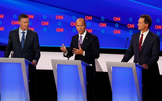 Former Colorado Gov. John Hickenlooper, former Maryland Rep. John Delaney and Montana Gov. Steve Bullock participate in the first of two Democratic presidential primary debates hosted by CNN Tuesday in the Fox Theatre in Detroit.