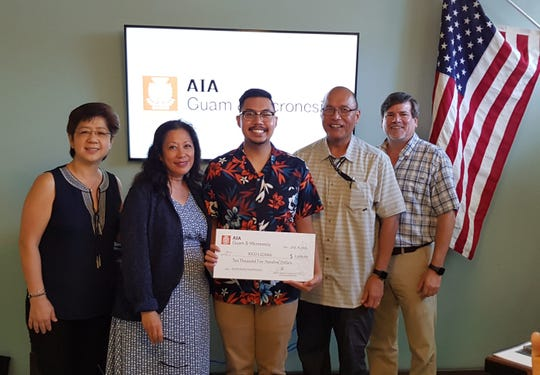American Institute of Architects Guam and Micronesia Chapter presented a $2,500 AIA scholarship check to Rico Lizama on July 18.  He will be a Junior at the University of Arizona this coming fall semester. From left: Melet Santos, Rico Lizama with his parents Mr. and Mrs. Lizama and Brent Wiese.