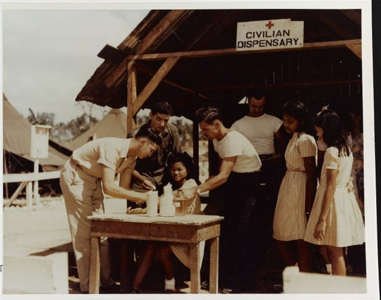 Local children are inoculated by Navy pharmacist's mates, circa late 1944 or early 1945. N
