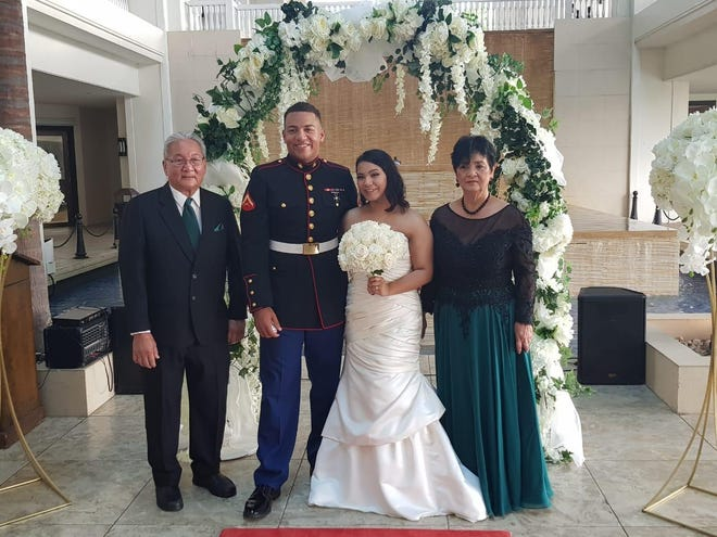 Kaleianani Joy Muna and Gregory Romero were married July 27 at Sheraton Laguna Guam Resort, officiated by Lt. Governor Josh Tenorio. Pictured with the couple is Ben and Mary Muna, grandparents of the bride.