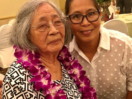 World War II survivor Maria Cruz Quitugua, 86, and her youngest child, Rosemary Quitugua Ferguson, during the Guam Chamber of Commerce's July 31, 2019 general membership meeting. The war survivor, the Chamber's guest speaker, says she hopes people learn from Guam's experiences during the Japanese occupation.
