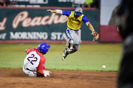 Dubois County Bombers' Benji Brokemond (22) is safe at second base as Henderson Flash's Josh Johnston (2) jumps for a wild pitch as the Henderson Flash play the Dubois County Bombers at League Stadium in Huntingburg Tuesday, July 30, 2019.