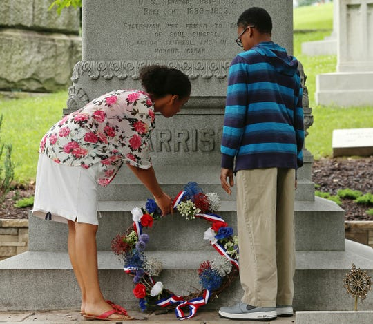 From left, Elisabeth Reese, 16, and Edwin Girton, 13, place a wreath on twenty-third president of the United States Benjamin Harrison's grave, Friday, July 3, 2015, at Crown Hill Cemetery, Indianapolis, Ind.