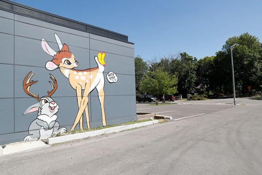A mural by Artist Jules Muck, also known by her tag Muckrock, replaces a previous mural on the side of Beholder, a restaurant located at 1844 E. 10th St., in Indianapolis, on Wednesday, July 31, 2019.