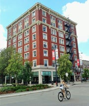 """The Hotel Jefferson building on East Washington Street was labeled """"Iowa's finest"""" when it opened in 1913. You can see where two more stories were added 15 years later. JFK once stayed here."""
