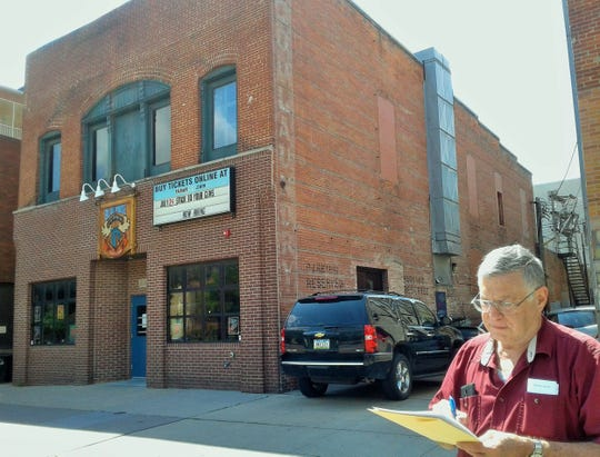 """Tom Schulein is intrigued with the current Blue Moose Tap House building, which started life in about 1897 as C.O.D. Laundry, a proud business along """"Laundry Row"""" on Iowa Avenue."""