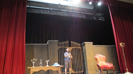"""Doug Lestina helps set up for Combined Effort Theatre's first radio -play, """"Children of the Moors."""" The performance will be stage Aug. 2-4 in Opstad Auditorium at City High School."""