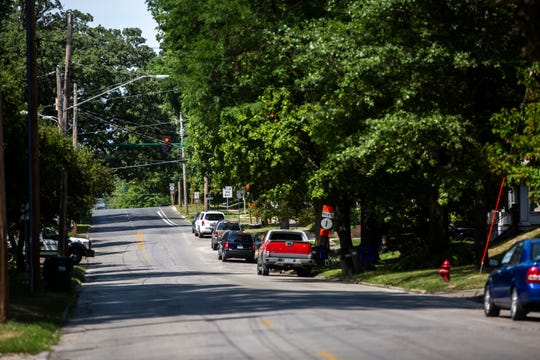Cars park along the street, Wednesday, July 31, 2019, along Governor Street, south of Burlington Street, in Iowa City, Iowa.