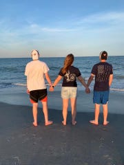 Deb Stayer Kelly with her teenage sons Bryce and David during the family's recent vacation to Kure Beach, North Carolina.