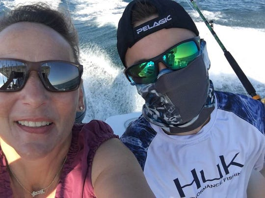 Deb Stayer Kelly and her son during a deep sea fishing trip in North Carolina.
