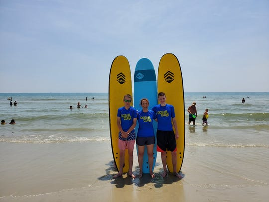 Deb Stayer Kelly with her sons David, left, and Bryce, right, during a surf lesson provided by Ocean Cure during the family's recent North Carolina vacation.