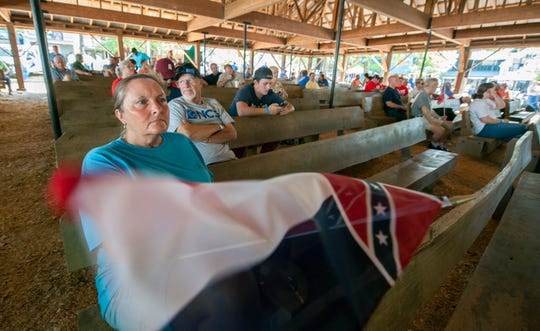 "Bobbie Witcher, of Philadelphia, joins others gathering at the Pavillion in Founders Square at the Neshoba County Fair to hear what the political candidates have to say. ""This is a tradition, coming to the fair,"" Witcher says. But it's the first time for Witcher to listen to the candidates. ""I'm curious — more concerned. I'm a farmer. I want to know what they're going to do for the working people."""
