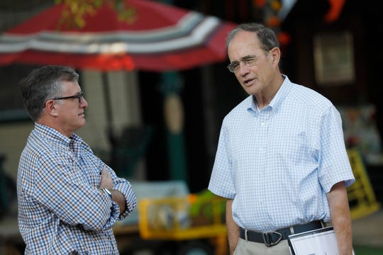 Rep. Jay Hughes, D-Oxford, left, and Republican Secretary of State Delbert Hosemann, confer at the Neshoba County Fair in Philadelphia, Miss., Wednesday, July 31, 2019. The two are seeking their respective parties nominations for lieutenant governor, and both spoke at the Fair. Candidates running in party primaries for statewide offices and district posts take advantage of the large gathered crowd at the fair who attend for the speeches.