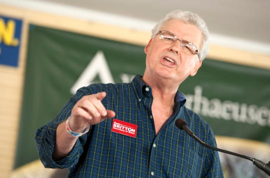 Sam Britton, Republican candidate for Secretary of State, addresses the crowd in the pavilion in Founders Square at the Neshoba County Fair Wednesday, trying to reinforce the differences between him and his opponent.