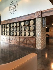 A wall composed of empty whiskey barrels leads into The Stave bar at the new Georgia Blue location in Madison.