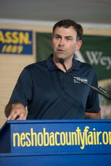 Michael Watson, Republican candidate for secretary of state, speaks in the pavilion in Founders Square at the Neshoba County Fair Wednesday, July 31, 2019, correcting what he perceives as inaccuracies about him in his opponent's ads.
