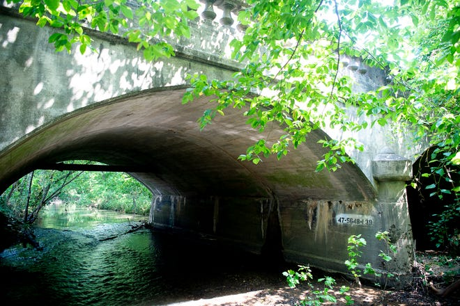 This 109-year-old bridge above First Creek on Mineral Springs Avenue will be torn down and replaced beginning in September.