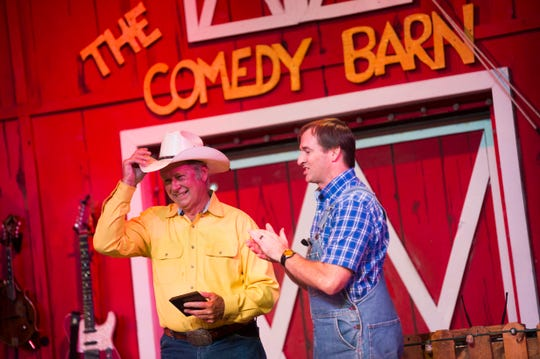 Performer Ron Jeffery is honored for his tenure as Danny Devaney applauds him at The Comedy Barn in Pigeon Forge, Tuesday, July 30, 2019. Jeffery as worked at The Comedy Barn for 25 years.