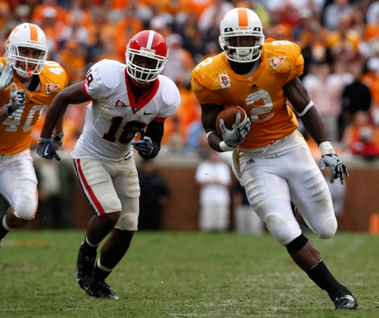 Tennessee's Monterio Hardesty (2) outruns Georgia's Bacarri Rambo (18) during the second half of an NCAA college football game Saturday, Oct. 10, 2009 in Knoxville, Tenn. Tennessee won 45-19. (AP Photo/Wade Payne)