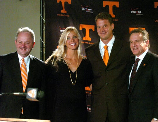 Dec. 1, 2008: Athletic director Mike Hamilton, left, new football coach Lane Kiffin with his wife, Layla, and UT president John Petersen pose for photographers after a press conference at Neyland Stadium. Kiffin stayed only 13 months before resigning to take the head coaching job at Southern California. (Michael Patrick/News Sentinel)