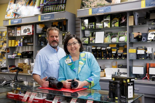 Owners Ross and Rena Aiken pose for a photo at Camera Outfitters, 2200 Elmwood ave., Wednesday, July 31, 2019 in Lafayette.