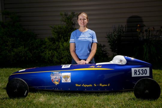 Abigail Mills poses next to her derby car, Tuesday, July 30, 2019 in West Lafayette. Mills won the 82nd All-American Soap Box Derby in Akron, Ohio on July 20th.