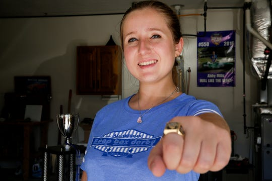 Abigail Mills poses with her championship ring, Tuesday, July 30, 2019 in West Lafayette. Mills won the 82nd All-American Soap Box Derby in Akron, Ohio on July 20th.