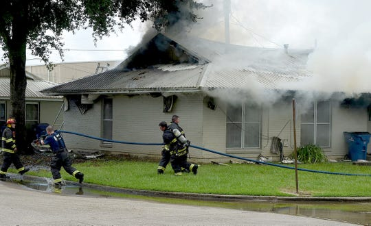 The Opelousas Fire Department works to put out a fire at the corner of Kim Drive and Lemoine Street on July 31, 2019.