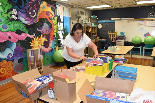 Laurie Bolden, a third-grade teacher at Cherokee Elementary School in Alexandria, La., gets her classroom ready for the upcoming school year.