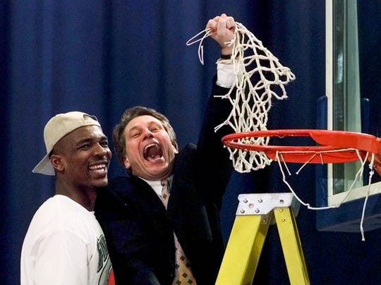Michigan State head coach Tom Izzo and Antonio Smith celebrate their 73-66 win over Kentucky in the NCAA Midwest Regional final in St. Louis on March 21, 1999.