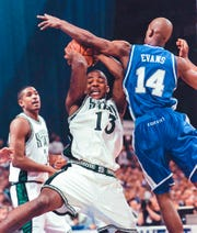 MSU's Antonio Smith, left, grabs a rebound away from Kentucky's Heshimu Evans during a game in 1999.